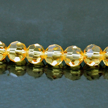 8mm Round Faceted Fire-n-Ice Crystal®, Topaz, strand