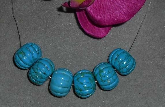 Carved howlite beads  20mm diameter x15mm